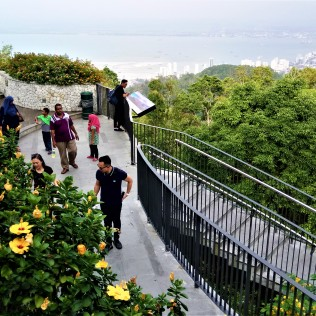 Enjoying the view and the flora atop Penang Hill. (photo credit : Shah Said ; @ all rights reserved)
