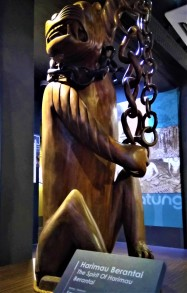 """A wood carving of the spirit """"Harimau Berantai', which is loosely translated as the spirit of the Chained Tiger. (photo credit : Shah Said ; @ all rights reserved)"""