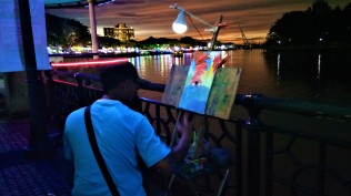 An Artist plying his craft by the Kuching waterfront. (photo credit : Shah Said ; @ all rights) reserved